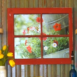 Old window frame with photo behind it.